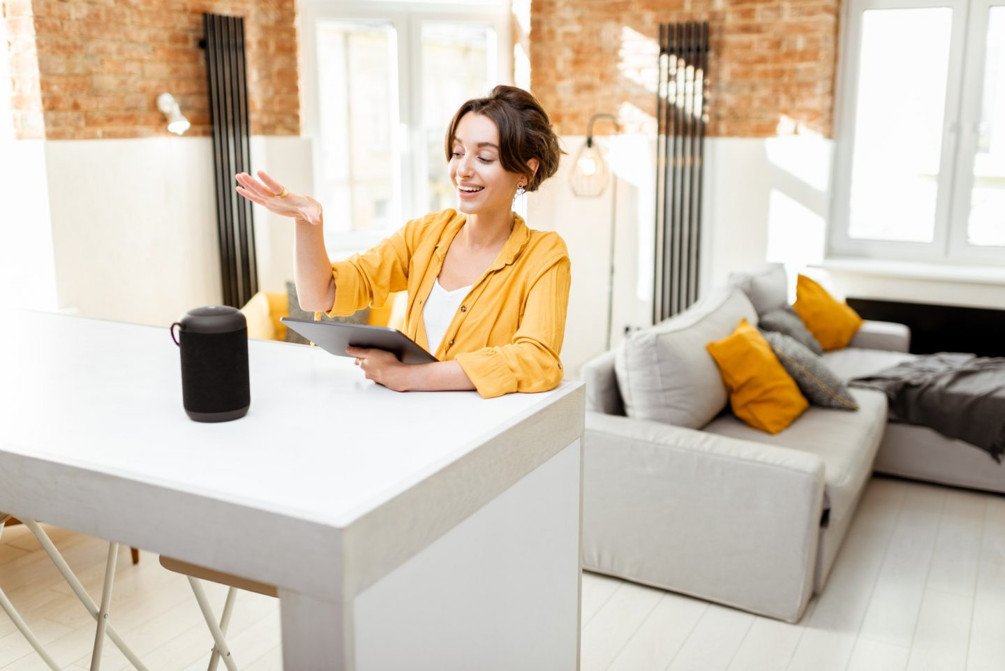 woman-controlling-smart-home-devices-with-a-voice-commands.jpg