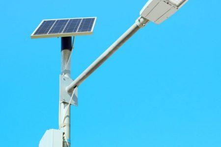 solar-panel-powered-street-light-lamp-on-blue-sky-background.jpg