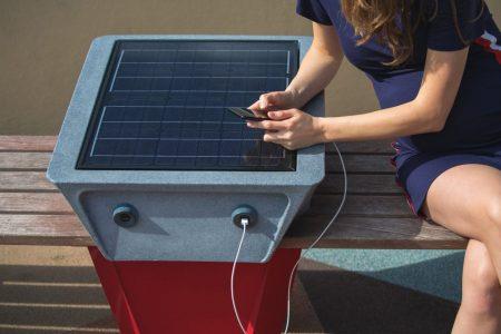 woman-charging-mobile-phone-via-usb-outdoors.jpg