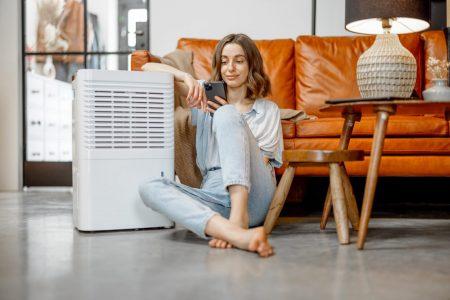 woman-sitting-near-air-purifier-and-moisturizer-appliance.jpg
