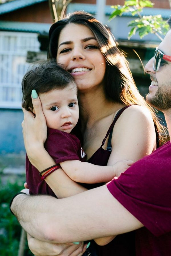 young-family-with-a-child-on-the-nature-2021-04-02-21-26-12-utc-scaled.jpg